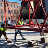 Maxim Crane Works workers hold a section of a huge luffing crane in position as it's joined to another section on Wednesday, Jan. 29. It's being used in construction of the Hamilton Canal District parking garage. (SUN/Julia Malakie)