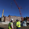 Work is done for the day on the Hamilton Canal District garage, with a giant luffing crane to lift precast columns and floors. The crane assembly was finished this morning, and it placed eight precast columns in its first half day of use. (SUN/Julia Malakie)