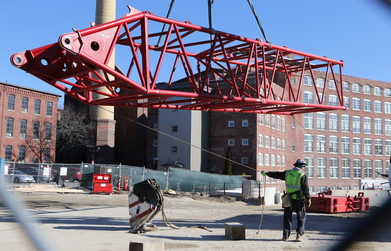 Maxim Crane Works workers assemble a huge luffing crane on Wednesday, Jan. 29. It's being used in construction of the Hamilton Canal District parking garage. (SUN/Julia Malakie)