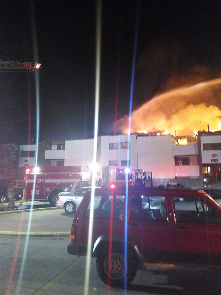 PHOTO COURTESY OF BRADLEY DIETRICH Flames engulfed a 12-unit building in the Hickory Hills Apartments complex at 208 Hemlock Court on Monday night in Brunswick.