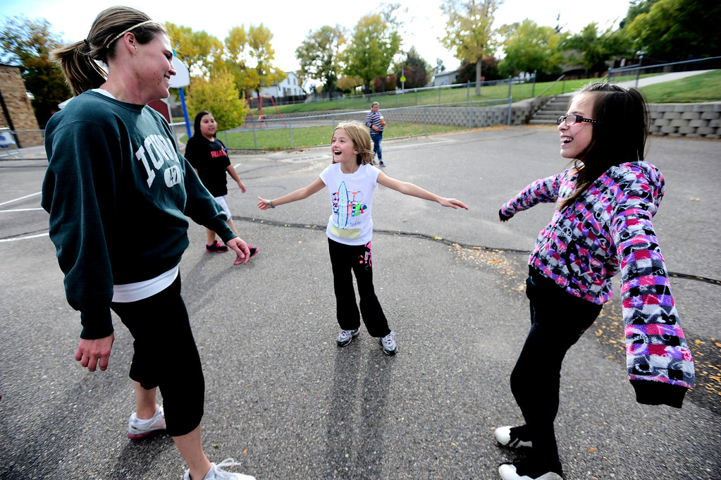 . Teacher Jennifer Rosenfels get ready to help Kassie Chapman and Jasmine Bryant, at right during positive body image tag game during a Girls on the Run of the Rockies meeting at Centennial Elementary School in Broomfield on Monday October 14, 2013. For more photos and a video from the group go to www.broomfieldenterprise.com Photo by Paul Aiken / The Broomfield Enterprise