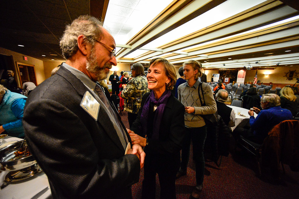 ". Vermont Secretary of Transportation Sue Minter, democrat nominee for the 2016 Vermont Gubernatorial race, talks with Steve Geller before the start of the ""Candidate Showcase\"" hosted by Vermont Businesses for Social Responsibility (VBSR) and the Brattleboro Area Chamber of Commerce (BACC) on Monday, Oct. 25, 2016. Kristopher Radder / Reformer Staff"