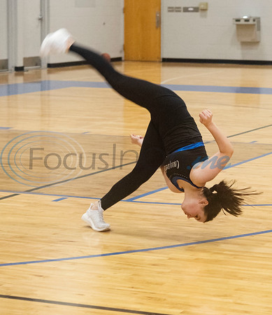 Daria Holcomb does a flip with the Grace Community School Cougarettes drill team as they rehearse a hip hop show on Thursday morning Feb. 20, 2020 at the school's gymnasium. The team will perform during halftime at the Harlem Globetrotters game at the Herrington Patriot Center in Tyler on Friday night.