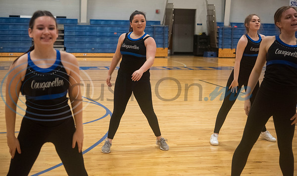 The Grace Community School Cougarettes drill team rehearses a hip hop show on Thursday morning Feb. 20, 2020 at the school's gymnasium. The team will perform during halftime at the Harlem Globetrotters game at the Herrington Patriot Center in Tyler on Friday night.