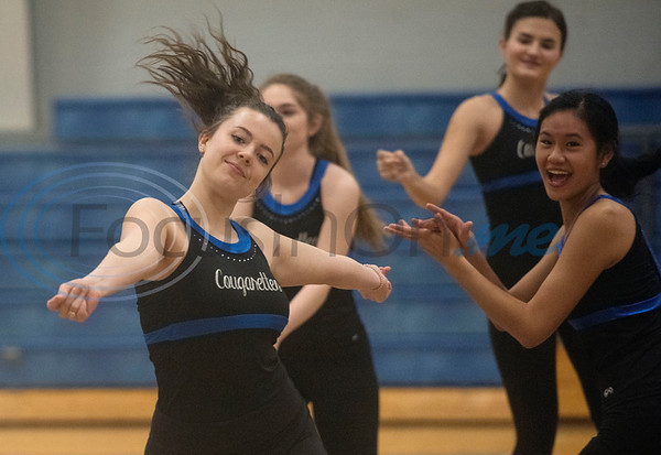 Kenna Flynn, left, dances with the Grace Community School Cougarettes drill team as they rehearse a hip hop show on Thursday morning Feb. 20, 2020 at the school's gymnasium. The team will perform during halftime at the Harlem Globetrotters game at the Herrington Patriot Center in Tyler on Friday night.