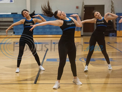 The Grace Community School Cougarettes drill team rehearses a hip hop show on Thursday morning Feb. 20, 2020 at the school's gymnasium. The team will perform during halftime at the Harlem Globetrotters game at the Herrington Patriot Center in Tyler on Friday night. Pictured from left: Vivianne Wong, Kenna Flynn and Hope Lindley.
