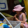 KRISTOPHER RADDER — BRATTLEBORO REFORMER<br /> Morgan Broadworth, 5, of New York City, looks through a box of donated toys during the annual Grace Cottage Hospital Auxiliary Fair Day at the Townshend Common on Saturday, Aug. 3, 2019.