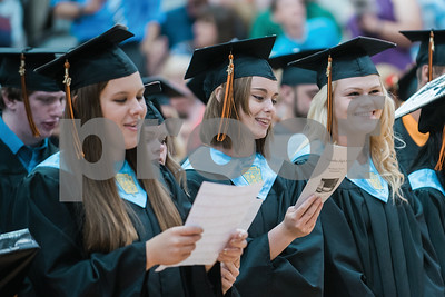 From left, Vanessa Walters, Megan Smith and Brittany Buck sing the alma mater during the Waterloo High School Commencement Ceremony Saturday June 25, 2016. Gabrielle Plucknette/Finger Lakes Times