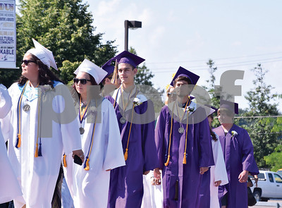 Sodus Central School Class of 2016 line up and make their way in the Procession to their Graduation ceremony on Saturday morning.