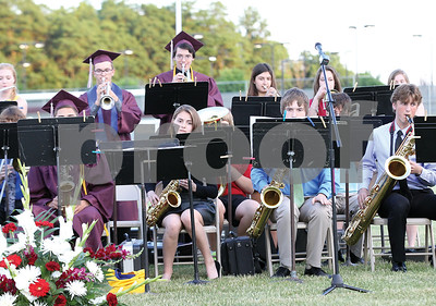 Spencer Tulis / Finger Lakes Times Newark Central School held its annual Commencement Friday evening outside on the football field. The school's jazz ensemble performs at the event.