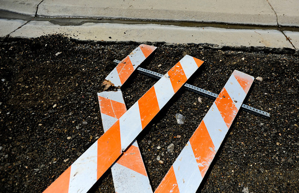 A fallen road sign sits in the dirt in the road construction zone on Grayden Court in Superior, Colorado July 10, 2012. Rachel Woolf/ For the Daily Camera