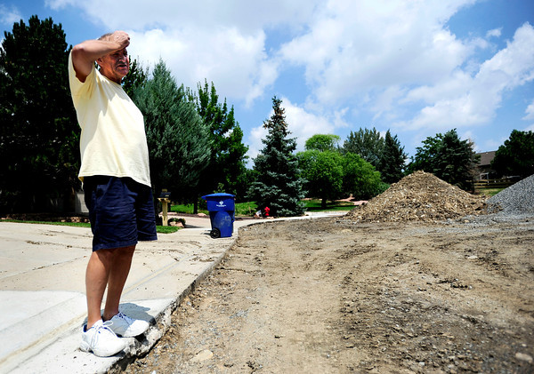 Alan Hafer, of Superior, stands outside his house to look out into the road construction zone on Grayden Court in Superior, Colorado July 10, 2012. Rachel Woolf/ For the Daily Camera