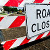 A road closed sign is displayed at the beginning of  the road construction zone on Grayden Court in Superior, Colorado July 10, 2012. Rachel Woolf/ For the Daily Camera