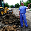James MacInnis, of Superior, stands outside his home and points to different areas of the road construction zone on Grayden Court in Superior, Colorado July 10, 2012. Rachel Woolf/ For the Daily Camera