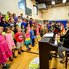 "KRISTOPHER RADDER - BRATTLEBORO REFORMER<br /> Rita Corey, the director of ""River Child, Legends of the Great Rivers of the World,"" leads the children at Dummerston Elementary School in rehearsals on Tuesday, May 8, 2018."