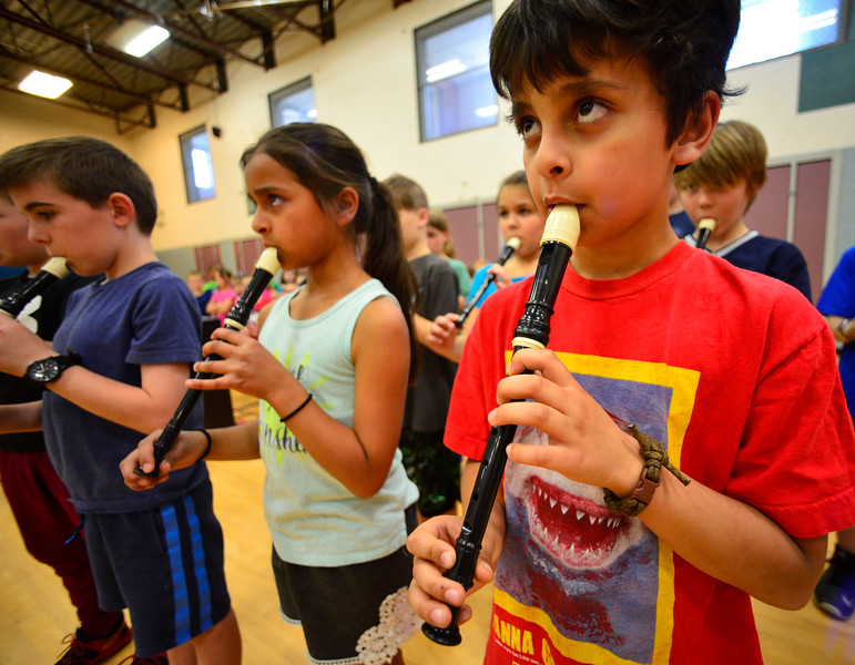 "KRISTOPHER RADDER - BRATTLEBORO REFORMER<br /> Marek Barone-Benoit, a 3rd-grader at Dummerston Elementary School, plays a recorder during a rehearsal for ""River Child, Legends of the Great Rivers of the World,"" on Tuesday, May 8, 2018. The show is directed by Rita Corey. People can attend the show at 6:30 p.m. at the Dummerston Elementary School on Wednesday, May 8, 2018."