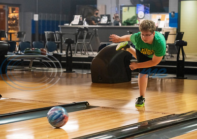 Trey McCoy, 12, bowls at Green Acres Bowl in Tyler on the business's first day back open after being closed due to the Covid-19 pandemic. The bowling alley has been a staple in the community for over five decades.