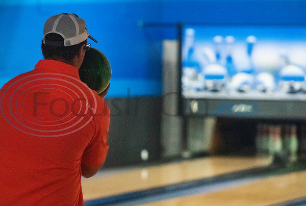 Dakota Farias bowls at Green Acres Bowl in Tyler on the business's first day back open after being closed due to the Covid-19 pandemic. The bowling alley has been a staple in the community for over five decades.