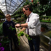 KRISTOPHER RADDER - BRATTLEBORO REFORMER<br /> John Mitchell, the horticulture teacher at Keene High School, shows Roy Snow, a freshman from Winchester, N.H., how to properly pluck a flower on Tuesday, May 1, 2018.