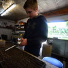 KRISTOPHER RADDER - BRATTLEBORO REFORMER<br /> Winchester resident Roy Snow, a freshman at Keene High School, uses a custom tool to spread seeds.