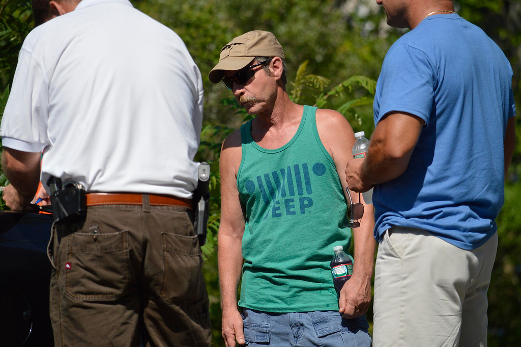 . Jim Lusher attends the search for clues about the dissapearance of his son James at Greenwater Pond in Becket, Tuesday July 16, 2013. Ben Garver / Berkshire Eagle Staff