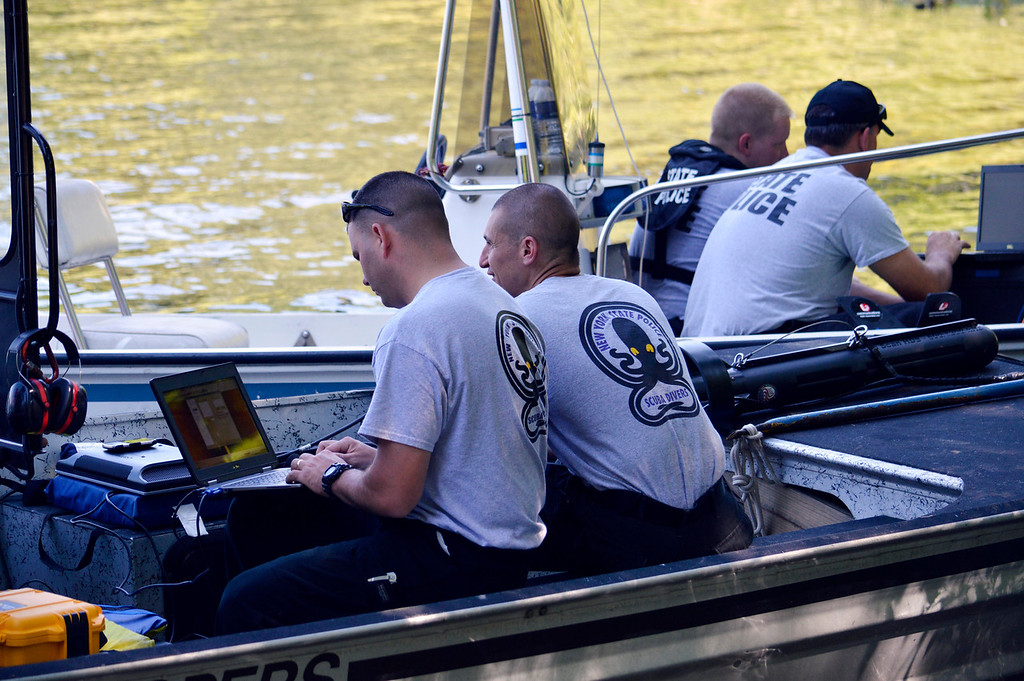 . Police from  Massachusetts and New York State use laptops to monitor sonar of Greenwater Pond in Becket for the search  for clues related to the alleged abduction of James Lusher by Lewis Lent, Tuesday July 16, 2013. Ben Garver / Berkshire Eagle Staff