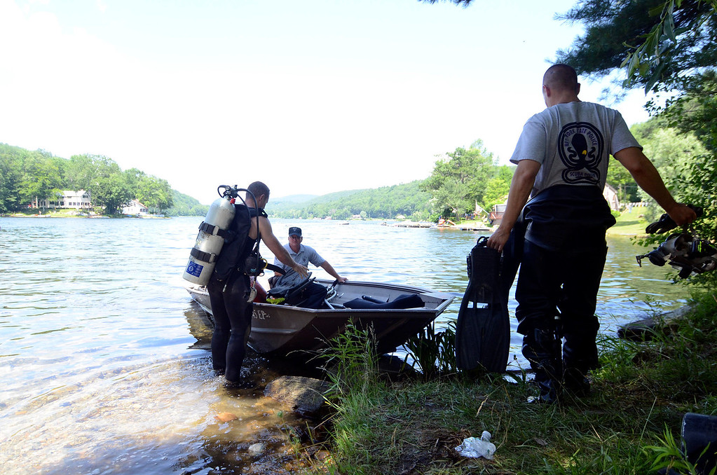 . DIvers embark on a search of Greenwater Pond in Becket for clues related to another possable victim of Lewis Lent, James Lusher, Tuesday July 16, 2013. Ben Garver / Berkshire Eagle Staff