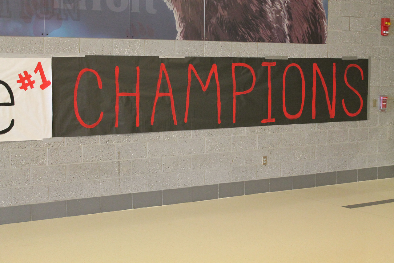 LAWRENCE PANTAGES / GAZETTE A new banner was posted nearby the Wadsworth High School gymnasium to congratulate the girls basketball state champion Grizzlies at an assembly Monday morning.