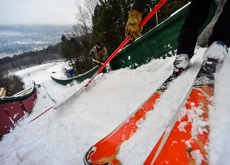 KRISTOPHER RADDER - BRATTLEBORO REFORMER<br /> Spencer Knickerbocker uses his skies to help push the snow down the inrun as crews prepare the hill for the Harris Hill Ski Jump in Brattleboro, Vt., on Tuesday, Feb. 15, 2017.