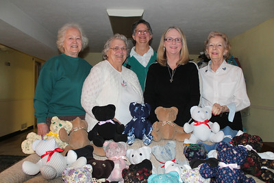 "LAWRENCE PANTAGES / GAZETTE Several women from Bennett's Corners Community United Method Church in Hinckley work together making ""comfort"" and ""memory"" stuffed bears for families with patients in hospice care. From left: Joan Kaminiecki-Gambert, Iola Carey, Rosemarie Beyer, Pastor Amy Shipley and Gloria Daugharty."