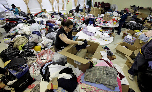 Volunteer Julie Purkiewicz boxes clothes donated for victims of the earthquake in Haiti at the Multi Ethnic Community Center Thursday, Jan. 14, 2010, in Houston. (AP Photo/David J. Phillip)