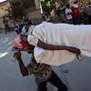 People carry an injured earthquake survivor in Port-au-Prince, Haiti, Thursday, Jan. 14, 2010.  A 7.0-magnitude earthquake struck Haiti Tuesday.  (AP Photo/Ramon Espinosa)