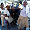Haitian women search through the rubble as they try to find loved ones and friends, Thursday, Jan. 14, 2010 near Port-Au-Prince, Haiti.  (AP Photo/The Miami Herald, Carl Juste) MAGS OUT; TV OUT; NO SALES