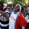 A woman mourns after the body of a  friend is removed from the rubble, . Thursday, Jan. 14, 2010 near Port-Au-Prince, Haiti.  (AP Photo/The Miami Herald, Carl Juste) MAGS OUT; TV OUT; NO SALES