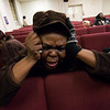 Liesette Lenai sobs  during a prayer service at the First Haitian Church of Grace in Charlotte, N.C., Wednesday, Jan. 13, 2010. Lenai says nearly all her family is still in Haiti, and she has heard no word from any of them. (AP Photo/The Charlotte Observer, Jeff Willhelm)
