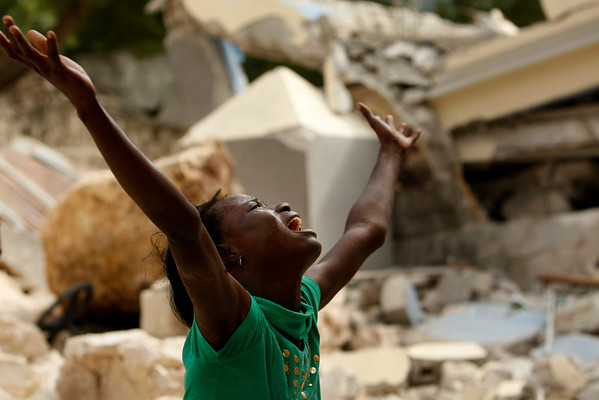 Cindy Terasme screams after seeing the feet of her dead 14-year-old brother Jean Gaelle Dersmorne in the rubble of the collapsed St. Gerard School in Port-au-Prince, Haiti, Thursday, Jan. 14, 2010.  A 7.0-magnitude earthquake hit Haiti Tuesday. (AP Photo/Gerald Herbert)