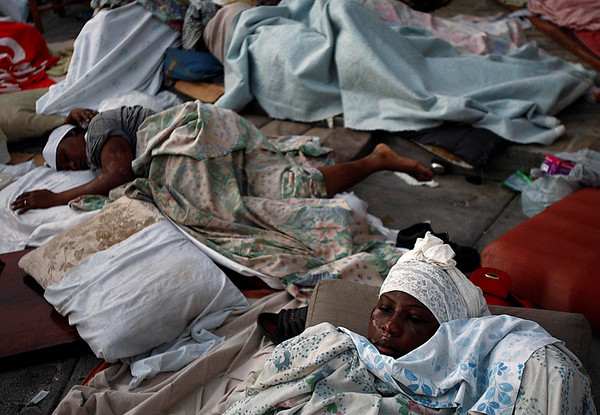 The injured camp out as they wait to be attended to by medical NGO (Hope For Haiti), Thursday, Jan. 14, 2010, in Petionville, Port-au-Prince, Haiti. Outside the Villa Creole Hotel, the injured from the surrounding area have come for shelter and medical attention. (AP Photo/Carl Juste, The Miami Herald) MAGS OUT; NO SALES; TV OUT