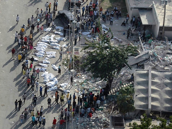 A Wednesday, Jan. 13, 2010 aerial photo provided by The American Red Cross shows survivors gathered around bodies in Haiti's capital Port-au-Prince during a joint Red Cross Red Crescent/ECHO (European Community Humanitarian Organization) aerial assessment mission following Tuesday's devastating earthquake. (AP Photo/ECHO, American Red Cross) MANDATORY CREDIT