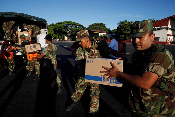 Nicaraguan soldiers load a plane with humanitarian aid to be sent to Haiti at Augusto C Sandino airport in Managua, Thursday, Jan. 14, 2010. A rescue team is preparing to depart for Haiti following Tuesday's 7.0 magnitude earthquake. (AP Photo/Esteban Felix)