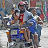 A family rushes and injured girl to a hospital, Wednesday, Jan. 13, 2010, in Port-AU-Prince, Haiti.  Tuesday's quake left a landscape of collapsed buildings _ hospitals, schools, churches, ramshackle homes, even the gleaming national palace _ the rubble sending up a white cloud that shrouded the entire capital. (AP Photo/The Miami Herald, Patrick Farrell) MAGS OUT; NO SALES; TV OUT