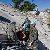 In this photo released by the United Nations, MINUSTAH peacekeepers search for survivors at the UN headquarters in Port-au-Prince, Haiti, Wednesday, Jan. 13, 2010.  A 7.0-magnitude earthquake struck Haiti Tuesday.  (AP Photo/United Nations, Logan Abassi)