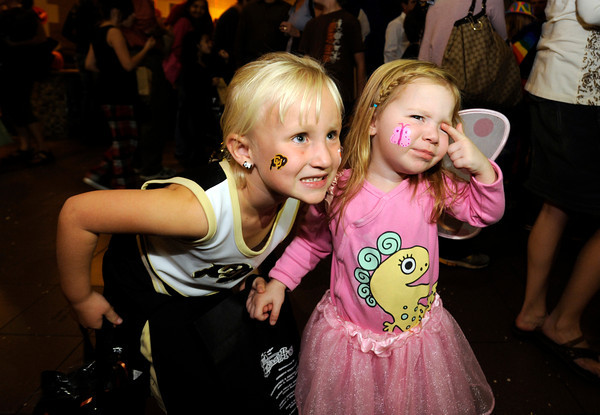 Gianna Isenburg, 5, and Finley Richardson, 2, at right poses for photos at the Halloween Party at the Arapahoe Center YMCA in Lafayette.<br /> Photo by Paul Aiken Monday Oct 24, 2011