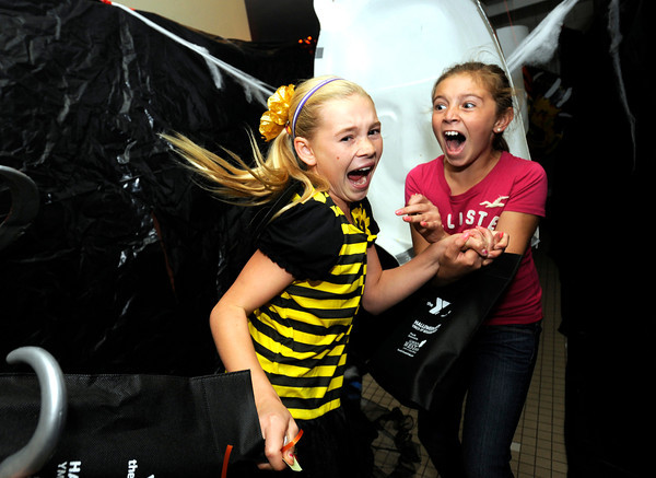 "Mahri Hereid, 10, at left and Sophie Moellenberg let out a scream in the haunted house at the  Halloween Party at the Arapahoe Center YMCA in Lafayette. For more photos of the halloween party go to  <a href=""http://www.dailycamera.com"">http://www.dailycamera.com</a><br /> Photo by Paul Aiken Monday Oct 24, 2011"