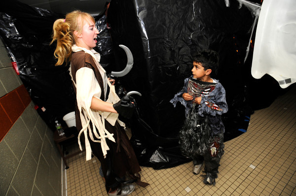"""Jordan Matosky, left jumps out to scare Bijan Jourabchi, 7, in the haunted house at the Halloween Party at the Arapahoe Center YMCA in Lafayette.For more photos from the halloween party go to  <a href=""""http://www.dailycamera.com"""">http://www.dailycamera.com</a>.<br /> Photo by Paul Aiken Monday Oct 24, 2011"""