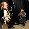 "Jordan Matosky, left jumps out to scare Bijan Jourabchi, 7, in the haunted house at the Halloween Party at the Arapahoe Center YMCA in Lafayette.For more photos from the halloween party go to  <a href=""http://www.dailycamera.com"">http://www.dailycamera.com</a>.<br /> Photo by Paul Aiken Monday Oct 24, 2011"