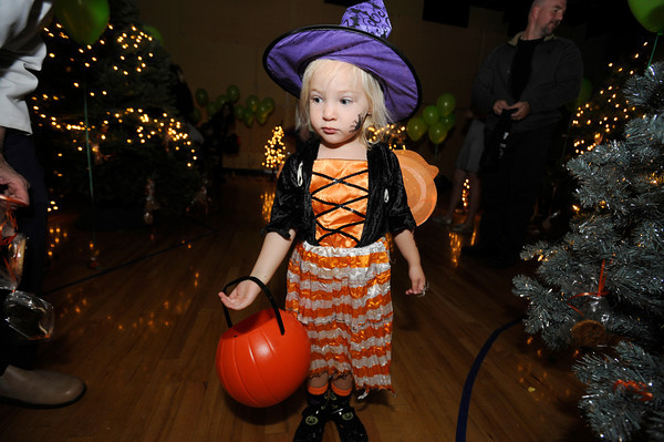 "Zoe Zettlemoyer, 3, looks for treats on trees at the Halloween Party at the Arapahoe Center YMCA in Lafayette. For more photos from the Halloween party go to  <a href=""http://www.dailycamera.com"">http://www.dailycamera.com</a><br /> Photo by Paul Aiken Monday Oct 24, 2011"