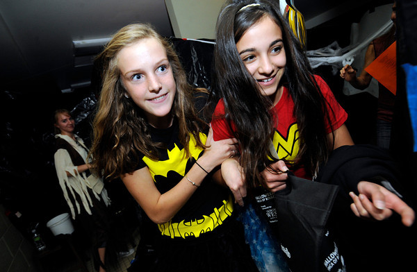 "Ellie Buck, left and Sophie Nasrullah hang onto one another as they go through the haunted house at the Halloween Party at the Arapahoe Center YMCA in Lafayette. For more photos from the halloween party go to  <a href=""http://www.dailycamera.com"">http://www.dailycamera.com</a>.<br /> Photo by Paul Aiken Monday Oct 24, 2011"