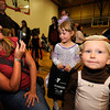 Kathy Kron leans back to get photos of her daughters Caroline, 4, and Clara, 2, at right at the Halloween Party at the Arapahoe Center YMCA in Lafayette.<br /> Photo by Paul Aiken Monday Oct 24, 2011