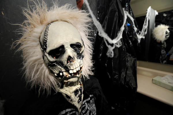 Maya Fohrman, plays a scary skeleton in the haunted house at the Halloween Party at the Arapahoe Center YMCA in Lafayette.<br /> Photo by Paul Aiken Monday Oct 24, 2011
