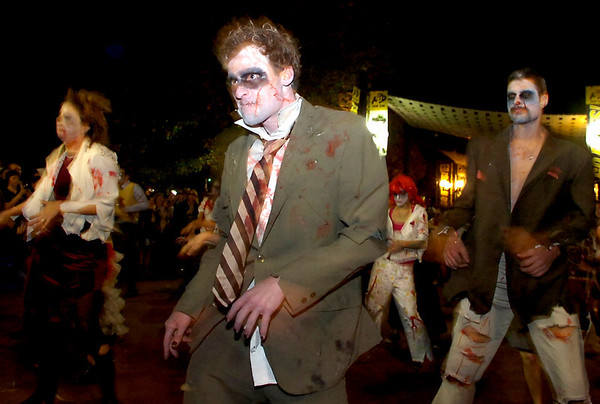 Karl Thompson leads the performers of Michael Jackson's Thriller on the Pearl Street Mall on Saturday October 30, 2010. <br /> Photo by Paul Aiken / The Camera
